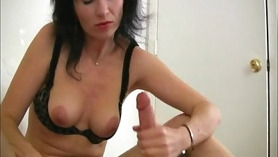 Mature brunette pleasures her pussy and strokes her lover's locate