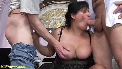 Lord it over dark-haired lady gets double fucked on a cozy sofa