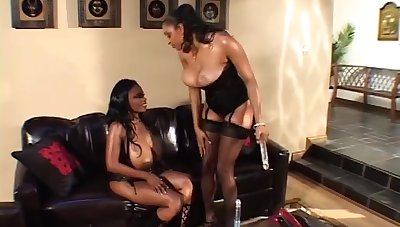 Diabolical couple milf play on the sofa with giant pink dildo, lick eachother and squirt on face