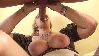 Mature with huge tits, serious POV action with a monster dick